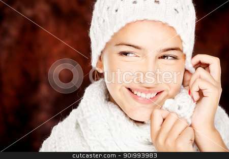 woman in wool sweater and cap stock photo, young happy brunette woman in wool sweater and cap, isolated on white by iMarin