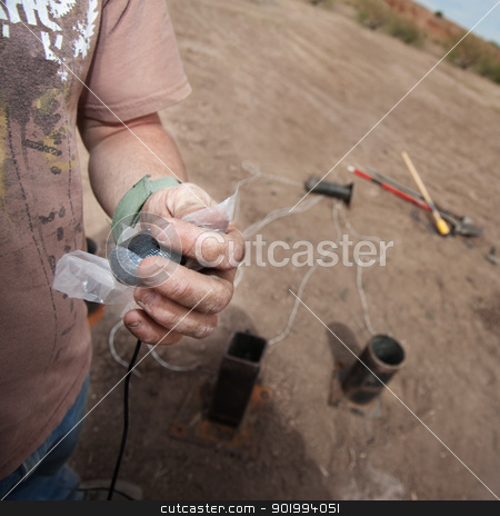 Motion Picture Team Setting Up Explosives stock photo, Close up of special effects expert wiring up explosives by Scott Griessel