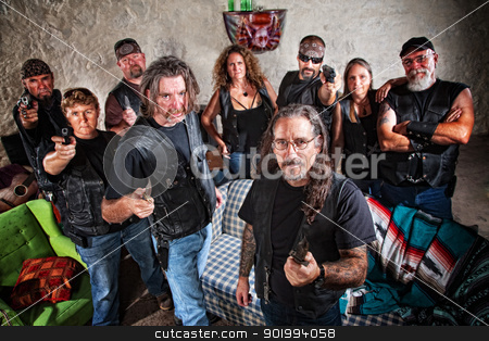 Nine Tough Biker Gang Members stock photo, Group of nine biker gang members in leather jackets indoors by Scott Griessel