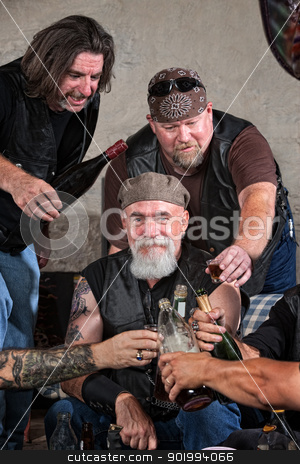 Happy Gang Members with Alcohol stock photo, Smiling gang members toasting with bottle of liquor by Scott Griessel