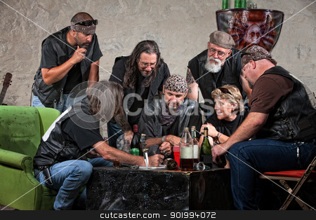 Gang Making Plans stock photo, Seven biker gang members writing a plan indoors by Scott Griessel