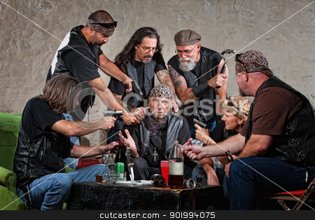 Biker Gang Robbery stock photo, Group of male and female biker gang members rob someone  by Scott Griessel