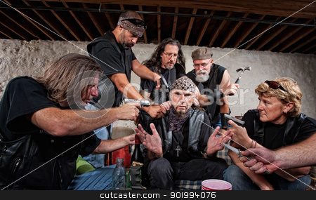 Bikers Threaten Sitting Man stock photo, Group of bikers in leather hold up sitting man by Scott Griessel