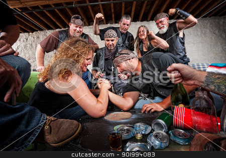 Lady Wins Arm Wrestling stock photo, Tough female gang member winning arm wrestling match by Scott Griessel