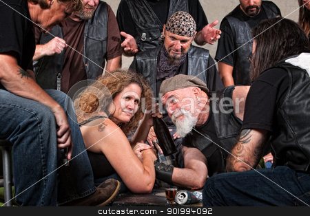 Female Arm Wrestler Wins stock photo, Smiling woman beats gang member in arm wrestling by Scott Griessel