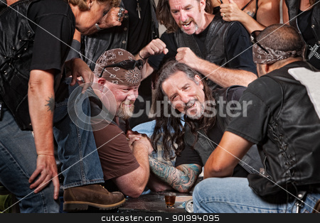 Man Loses Arm Wrestling Contest stock photo, Man loses an arm wrestling match with tough gang member by Scott Griessel