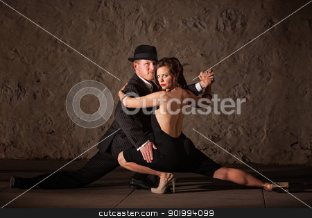 Attractive Tango Dancers stock photo, Attractive 1920s tango dancers holding each other near the floor  by Scott Griessel