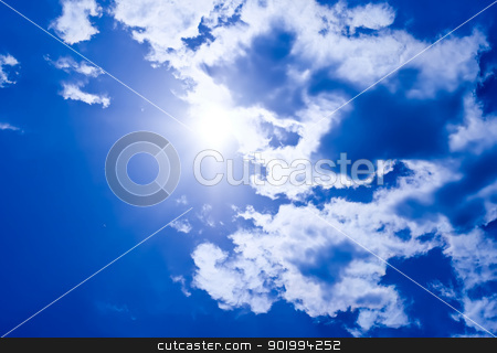 Sunny sky stock photo, Bright sunrays in a blue cloudy sky by Alexey Popov