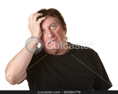 Man Holds His Head stock photo, Mature Caucasian man in black shirt holds head by Scott Griessel