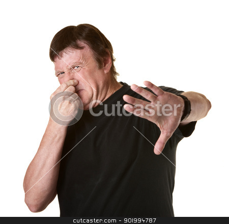 Man Pinches His Nose stock photo, Mature Caucasian man on white background pinches his nose  by Scott Griessel