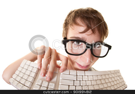 Nerd With Keyboard stock photo, Teen smiles behind a computer keyboard over white background by Scott Griessel