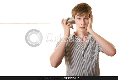 Youth With Tin Can Telephone stock photo, Skinny Caucasian teen with tin can phone over white background by Scott Griessel