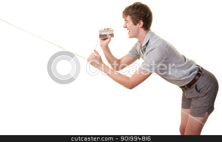 Teen Yells In Can stock photo, Skinny Caucasian man speaks on tin can phone over white background by Scott Griessel