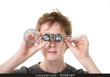 Young Jeweler stock photo, Young Caucasian man peers through jeweler's glasses over white background by Scott Griessel