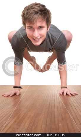 Teen In Bakasana Posture stock photo, Young Caucasian man in bakasana yoga posture over white background by Scott Griessel