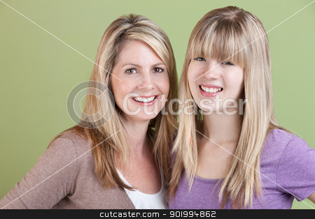 Mother and Daughter stock photo, Happy Caucasian mother and daughter smile over green background by Scott Griessel