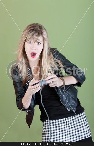 Teen Video Gamer stock photo, Young woman with video game controller over green background by Scott Griessel