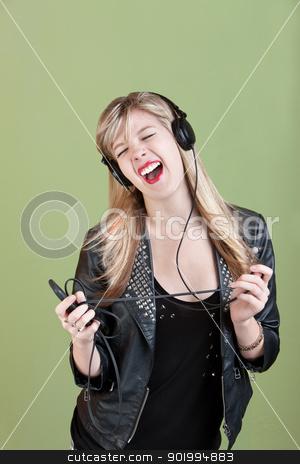 Teen Enjoys Music stock photo, Retro-styled Caucasian teen enjoys music on headphones by Scott Griessel