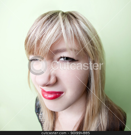 Girl with Wrinkled Nose stock photo, Cute young blond girl with wrinkled nose by Scott Griessel