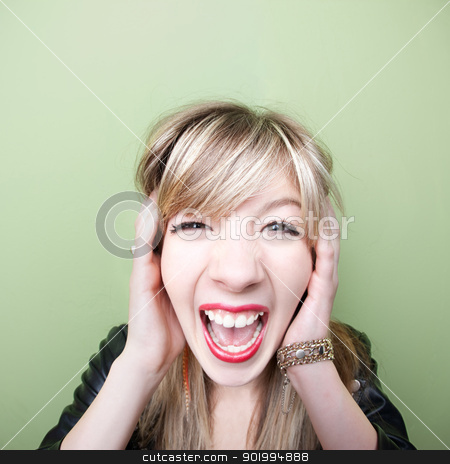 Woman Screams With Ears Covered stock photo, Young Caucasian woman screams with ears covered by Scott Griessel