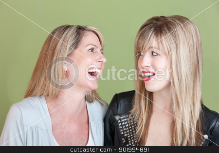 Happy Mother and Daughter stock photo, Caucasian mom with retro-styled daughter laugh together by Scott Griessel