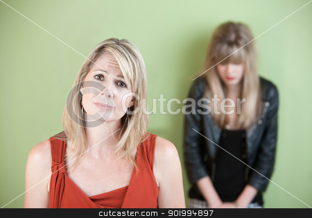Unhappy Mom stock photo, Unhappy Caucasian mom with sad daughter over green background by Scott Griessel
