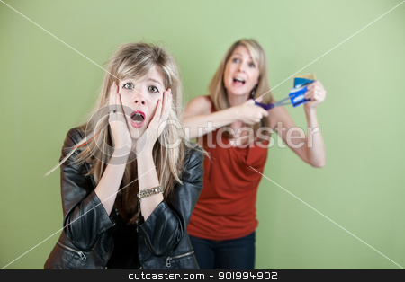 Credit Card Problems stock photo, Mom threatens to cut daughter's credit cards with a scissors by Scott Griessel