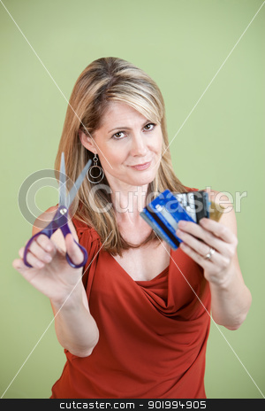 Cutting Credit Cards stock photo, Mature Caucasian woman with scissors and credit cards by Scott Griessel