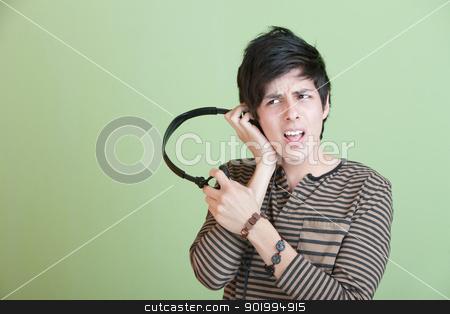 Teen Singing With Music On headphones stock photo, Teen Singing Along with Music On headphones by Scott Griessel
