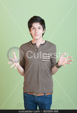 Hispanic Teen with Open Arms stock photo, Hispanic teen with open hands over green background by Scott Griessel