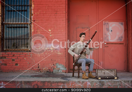 Bassoon Musician stock photo, Bassoon musician with open case for money performing outdoors by Scott Griessel