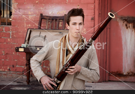 Bassoon Performer stock photo, Handsome young Caucasian man in Indian attire plays a Bassoon  by Scott Griessel