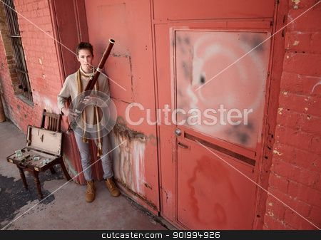 Handsome Young Bassoon Musician stock photo, Handsome young Caucasian Bassoon street performer by Scott Griessel
