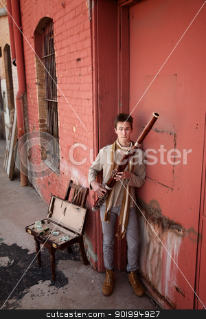 Bassoon Musician In Indian Attire stock photo, Young Caucasian bassoon musician in traditional Indian attire by Scott Griessel