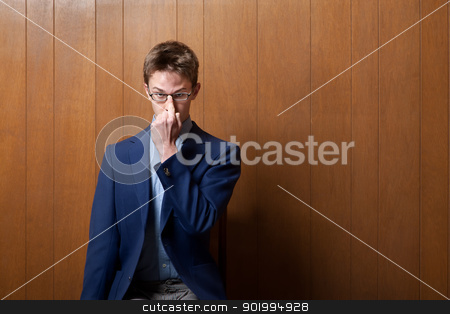 Young Man Adjusting Eyeglasses stock photo, Young nerdy Caucasian man adjusts his eyeglasses by Scott Griessel