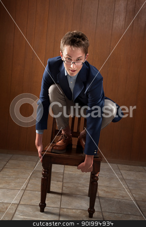 Bored Young Lad stock photo, Odd young Caucasian man on wooden chair by Scott Griessel
