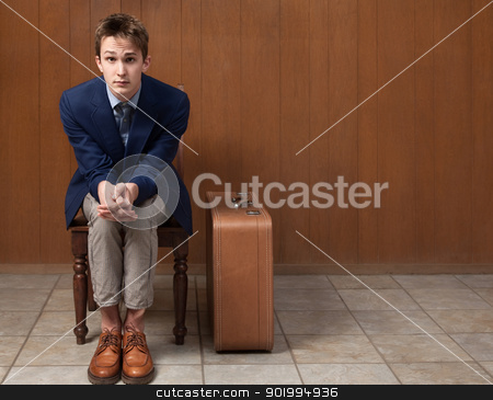 Serious Traveller stock photo, Serious young Caucasian traveller seated on chair by Scott Griessel
