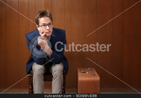 Bored Traveller stock photo, Bored Caucasian traveller sitting in a room by Scott Griessel