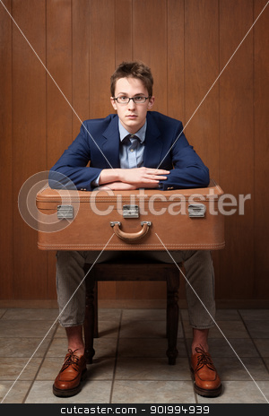 Serious Man With Suitcase stock photo, Serious Caucasian man sitting on chair with suitcase by Scott Griessel