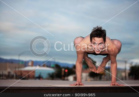 Young Man Doing Yoga stock photo, Young Caucasian man doing the Bakasana posture by Scott Griessel