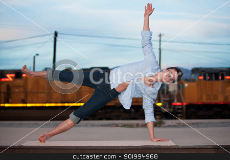 Man in Half Moon Position stock photo, Caucasian man performing the Half Moon yoga position by Scott Griessel