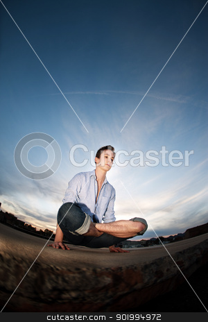Young Man Exercising stock photo, Young Caucasian man exercises outdoors on concrete by Scott Griessel