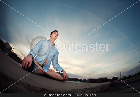 Young Man Meditating stock photo, Young Caucasian man meditating outdoors  by Scott Griessel