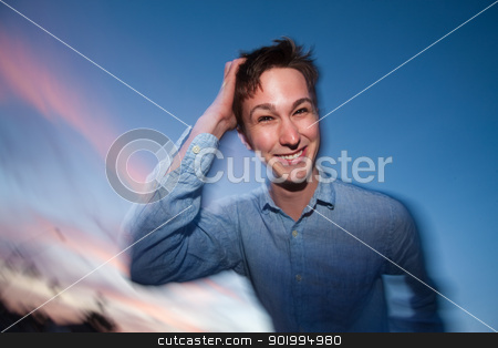 Man Scratches His Head stock photo, Young Caucasian man outdoor with hand on head by Scott Griessel