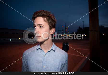 Young Man Outside at Night stock photo, Alone young Caucasian man outside at night by Scott Griessel