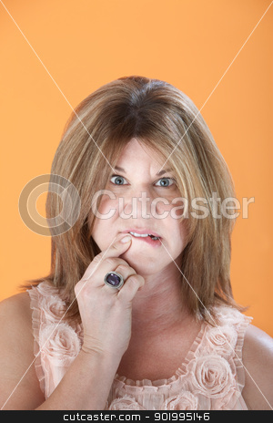 Worried Woman stock photo, Worried middle-aged Caucasian woman on orange background by Scott Griessel