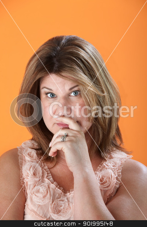 Confused Woman stock photo, Confused Caucasian woman on orange background by Scott Griessel