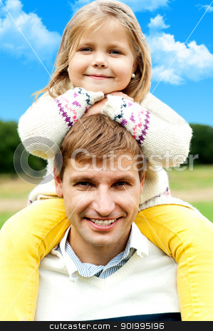 Charming little girl posing with her father stock photo, Charming little girl posing with her father against beautiful nature background by Ishay Botbol