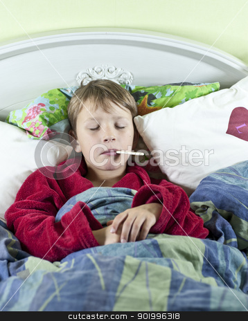 Boy in bed with fever stock photo, Young caucasian boy in bed with a thermometer in his mouth to check if he has fever by Johan Lenell