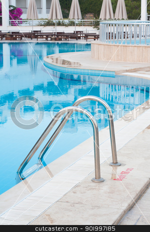 Ladder to Swimming Pool stock photo, Ladder to a swimming pool with clear blue water. by Brigida Soriano